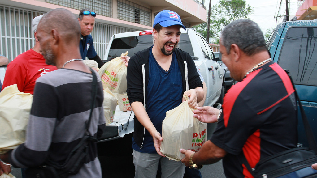 VEGA ALTA, PUERTO RICO - NOVEMBER 07:  Lin-Manuel Miranda delivers food to victims of Hurricane Maria at La Placita de Guisin on November 7, 2017 in Vega Alta, Puerto Rico.  (Photo by Gladys Vega/Getty Images)