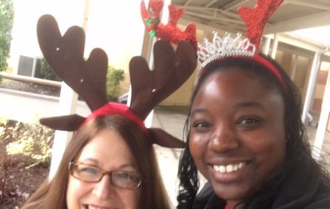 Ms. Rue and Mrs. Warren show their holiday spirit with festive antler headbands!