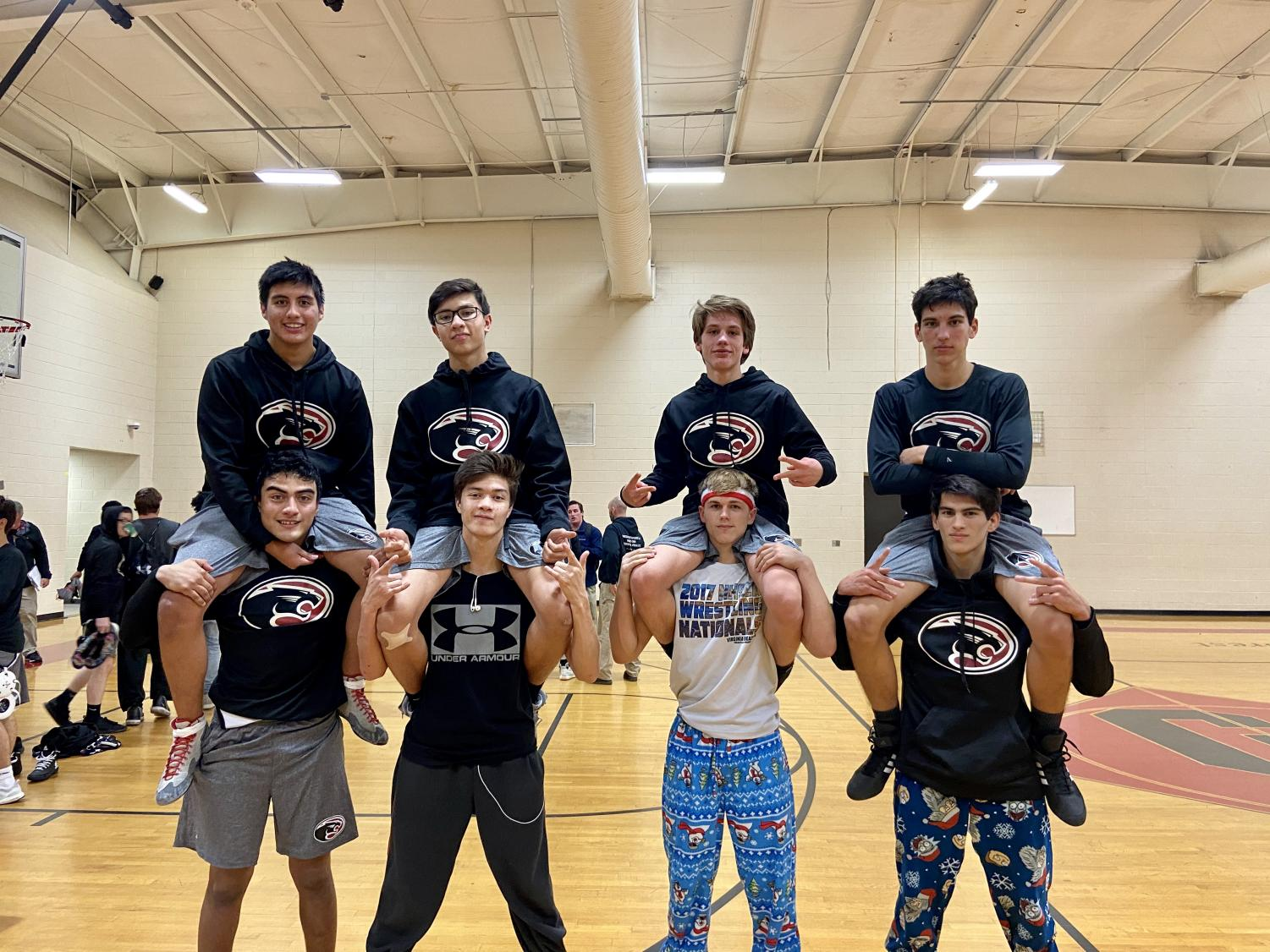 Left to right: Marlon Morales, Brandon Morales, Christian Gilbert, Michael Gilbert, Jayson Jacoby, Brandon Jacoby, Zachary Preciado, and Nicholas Preciado pose after wrestling Myrtle Beach High School. Not pictured: Dominic Gilbert